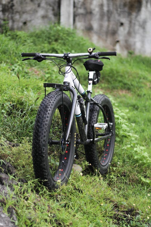 Black and Gray Mountain Bike on Green Grass Field