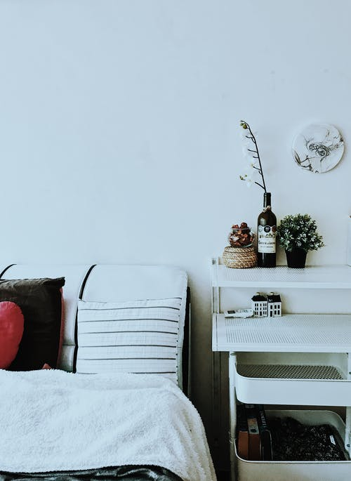 White Bed Beside Wall