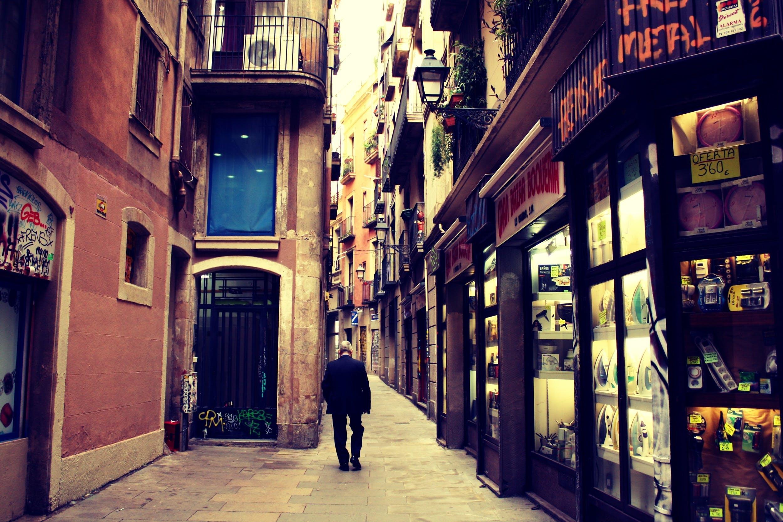 Man Walking Between Buildings