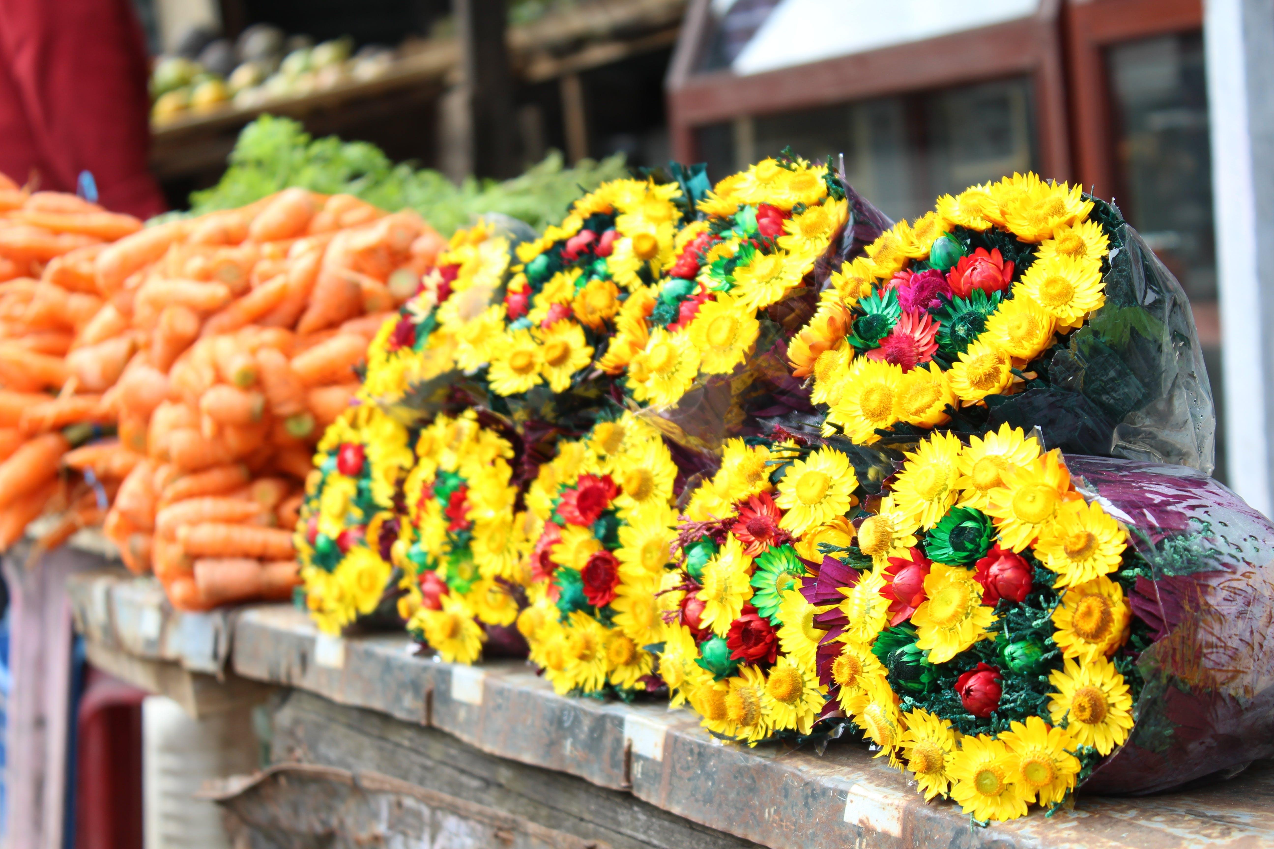 Free stock photo of street, yellow, flower, market