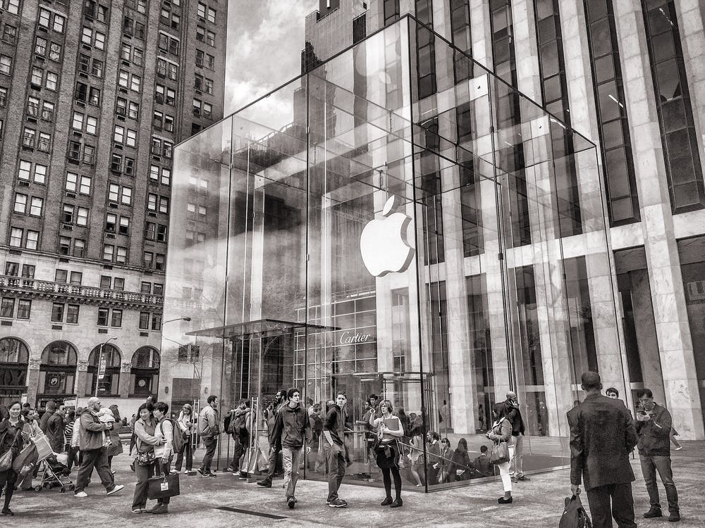 Group of People Walking in Apple Center