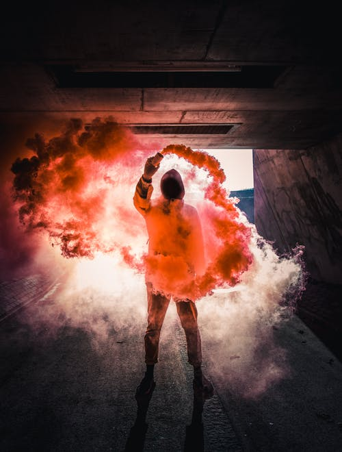 Photo Of Person With Colored Smoke