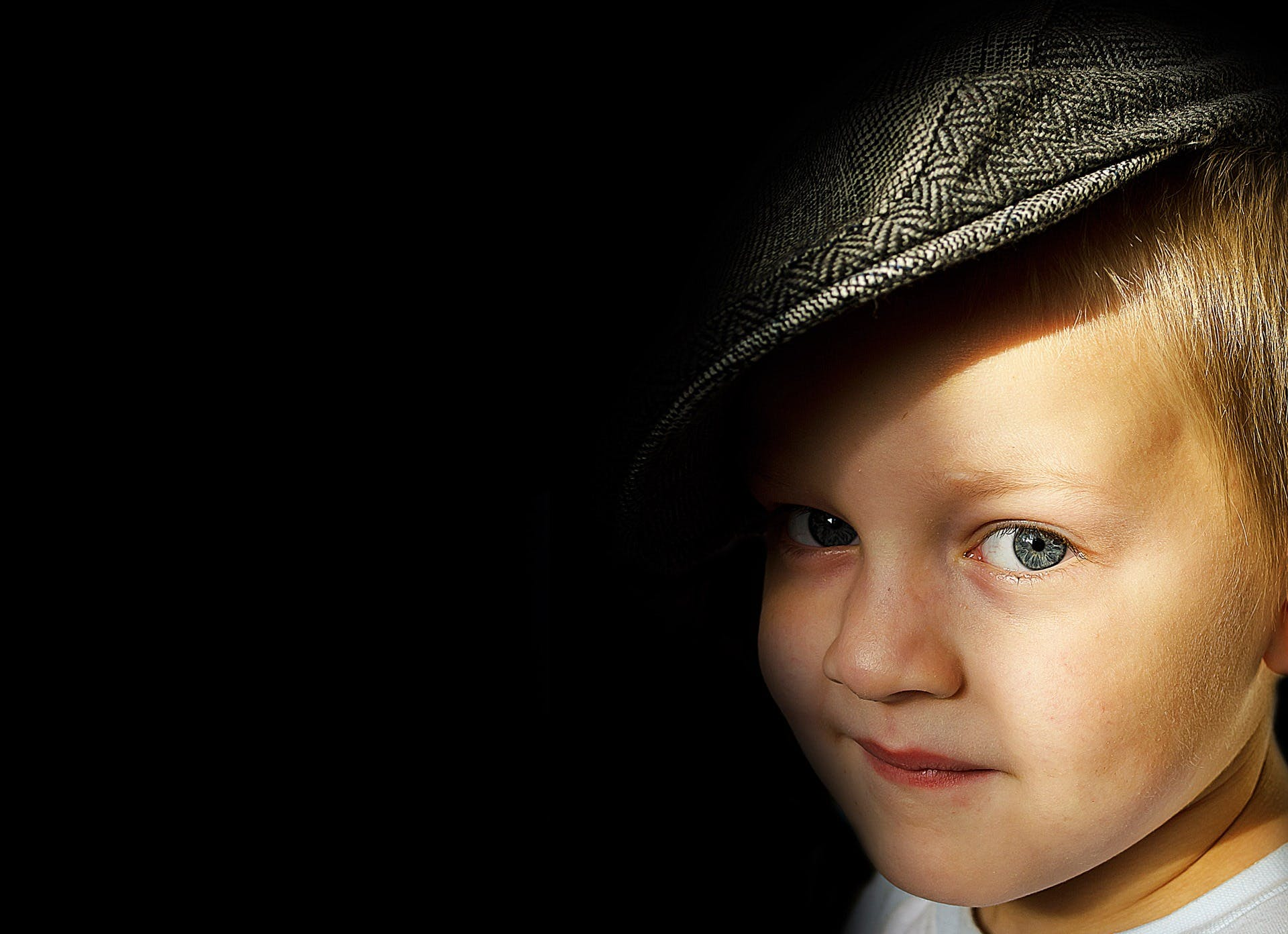 Boy Wearing Herringbone Flat Cap