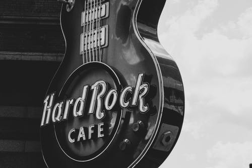 Greyscale Photo of Hard Rock Cafe Signage
