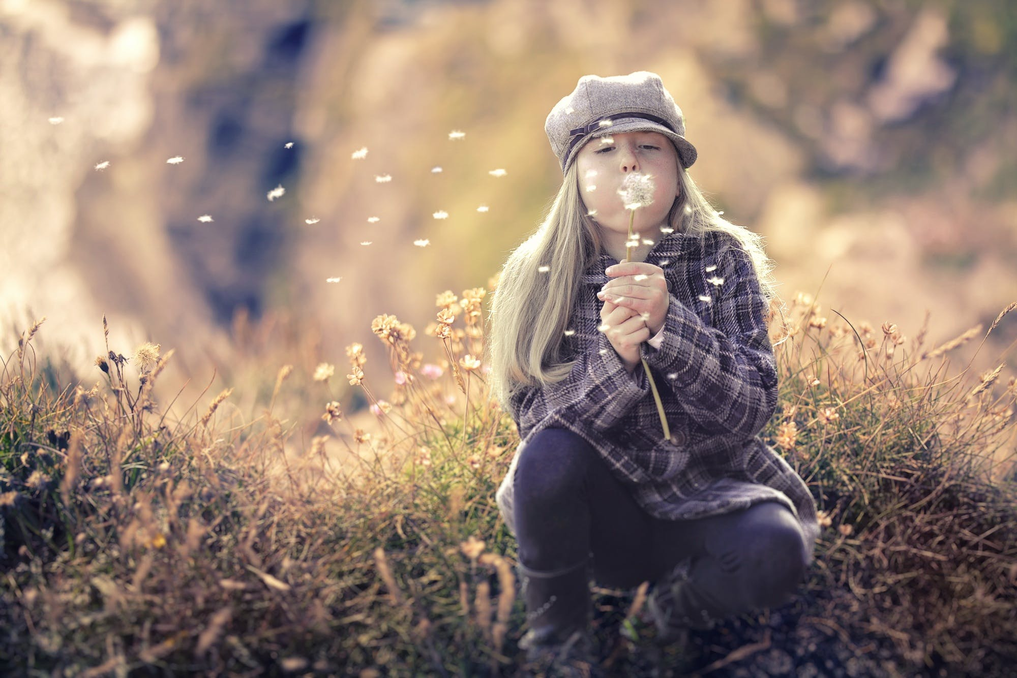 Girl Blowing Bubbles in Shallow Photo