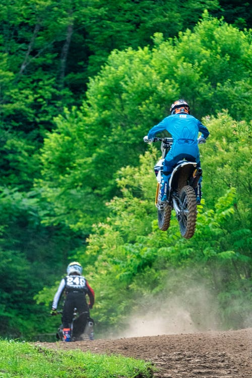 Two Men Riding Motocross Dirt Bikes