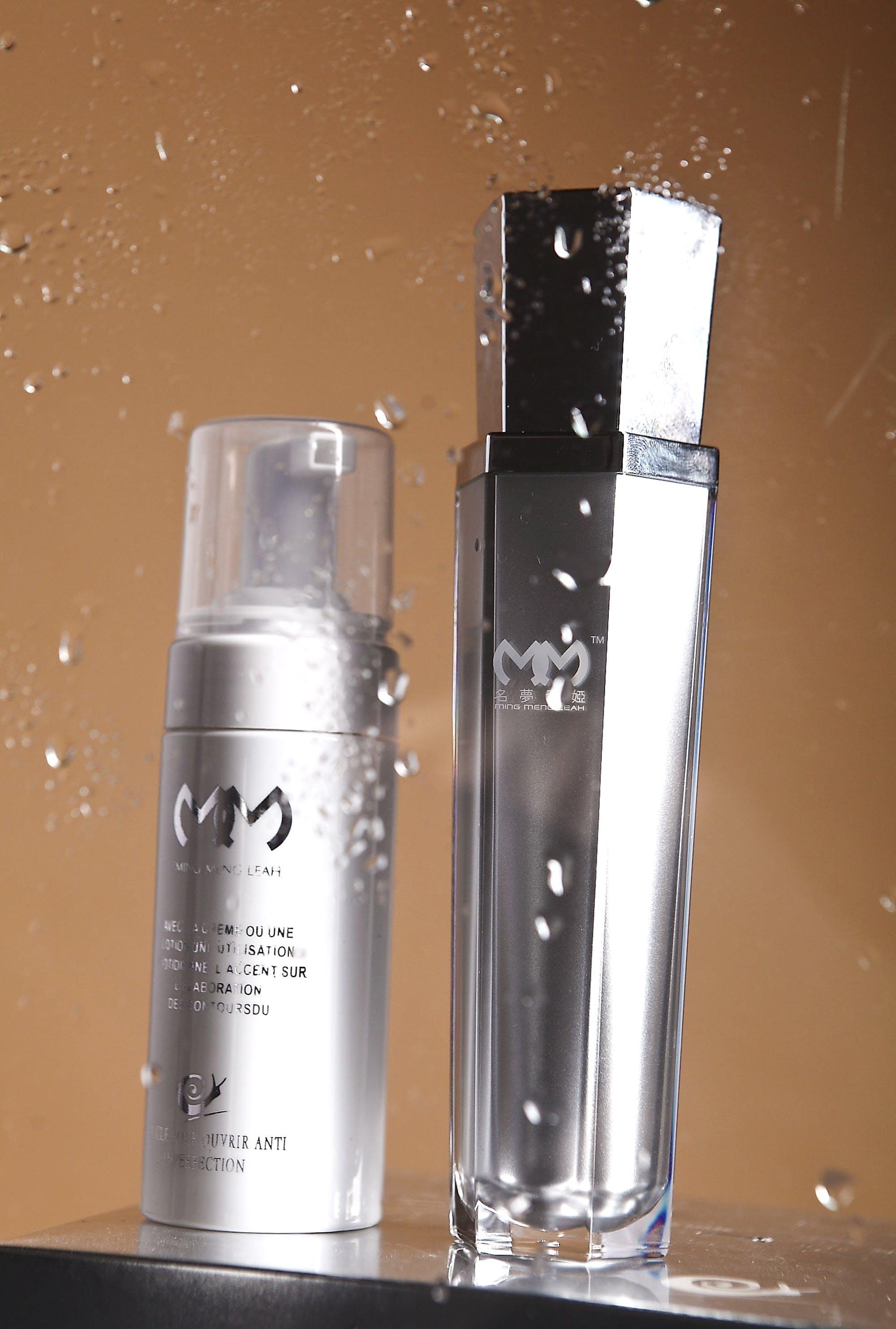 Two Silver Bottles