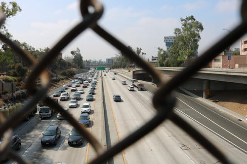 Free stock photo of chain link fence, highway, los angeles, traffic