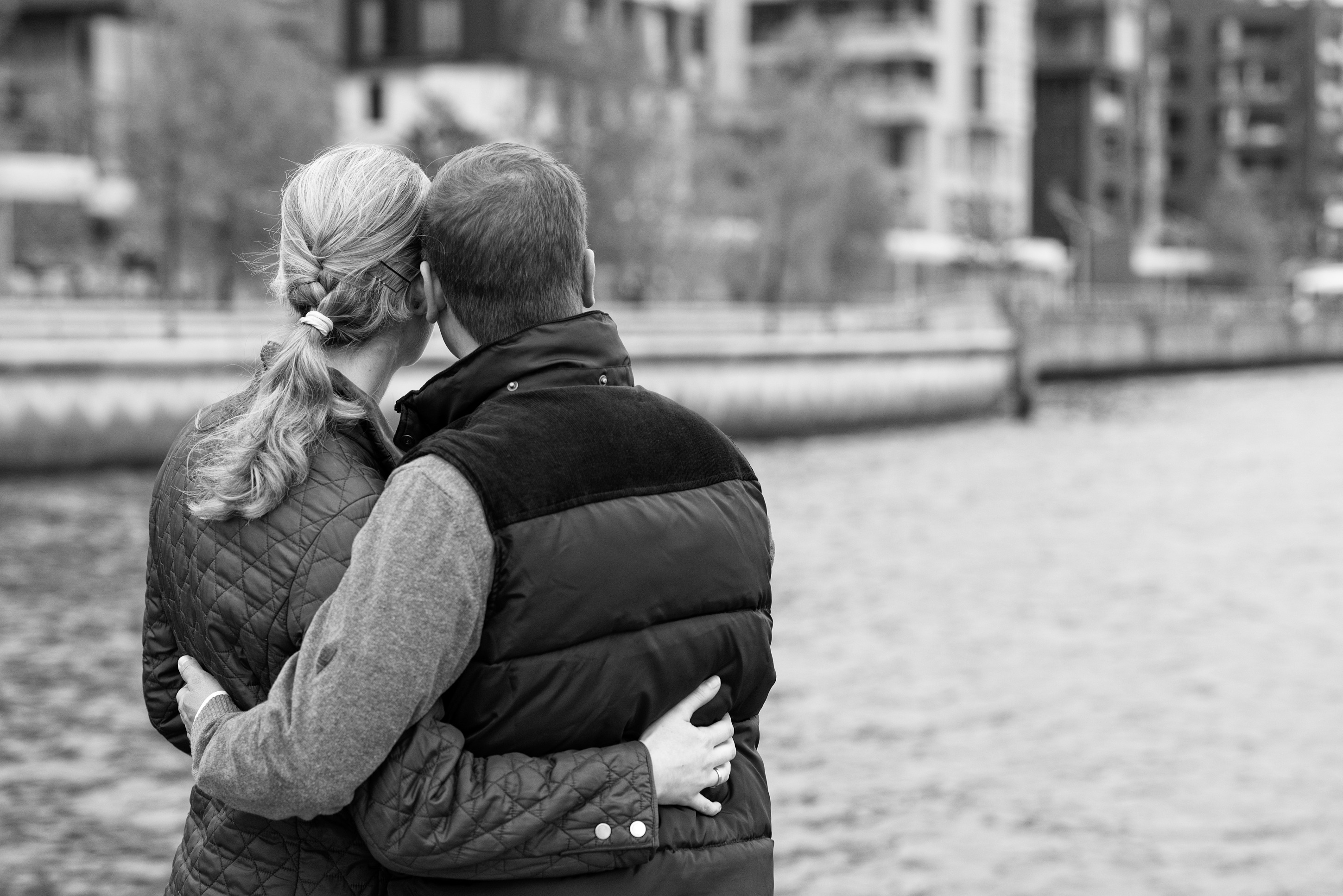Grayscale Photography of Man and Woman Holding Each Other