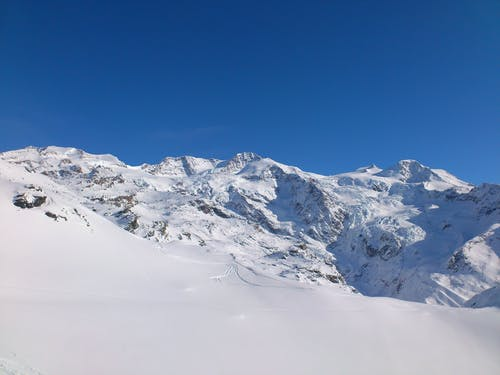 Snow-covered Mountain Under Blue Sky