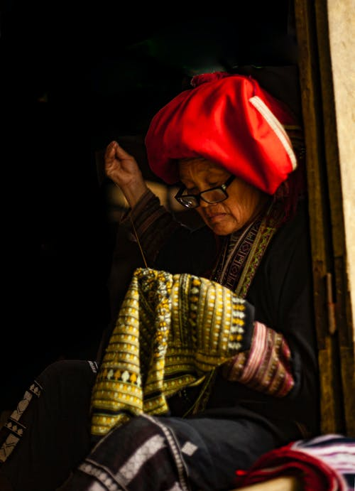 Photo of a Woman Sewing Clothes
