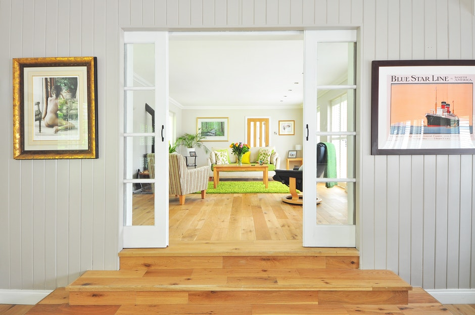 hard wood floors and green pop of color in this living room