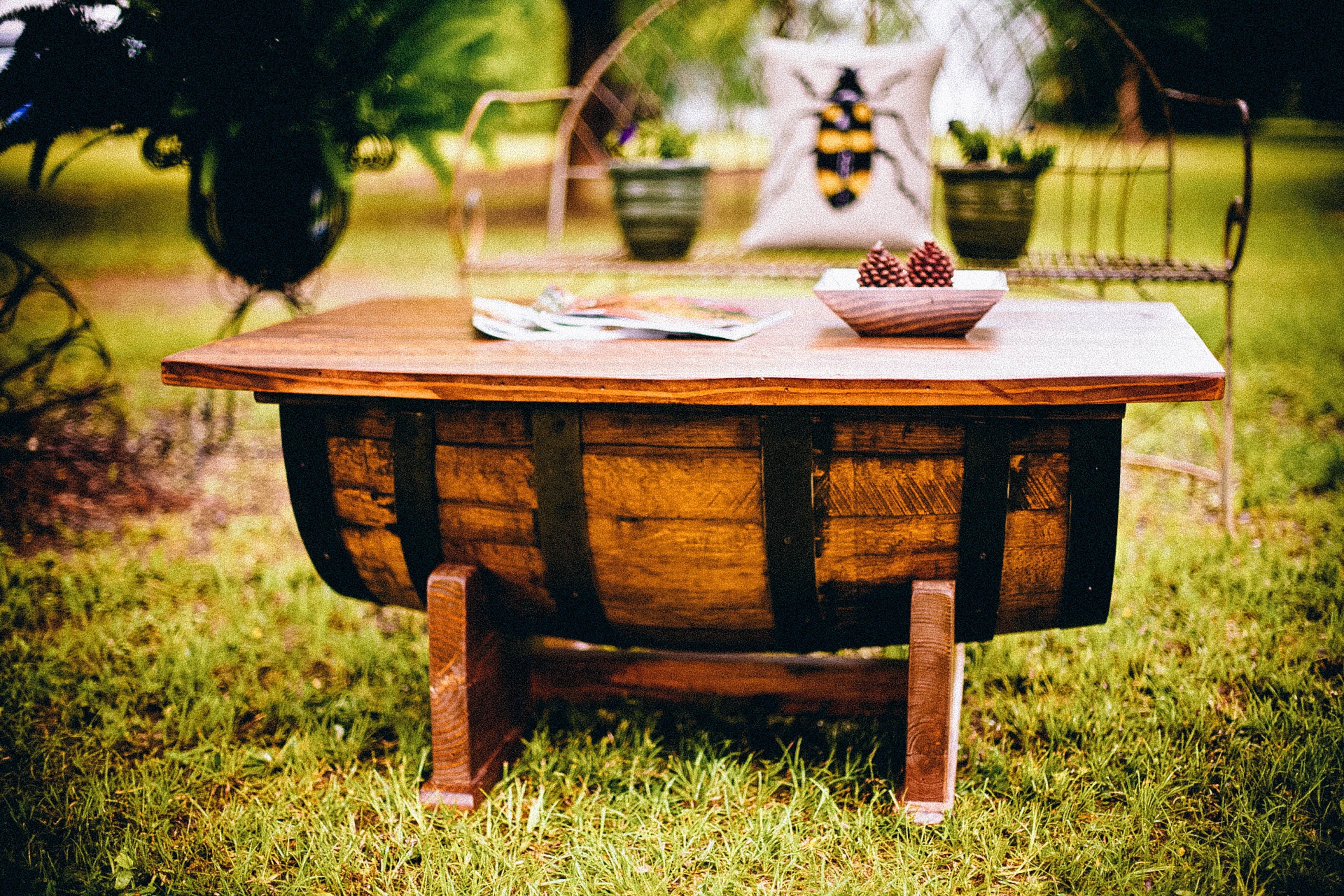 Selective Focus Photography of Brown Wooden Barrel Table