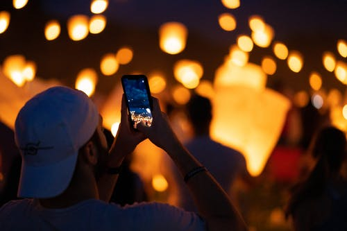 Person Taking Photo Of Lanterns