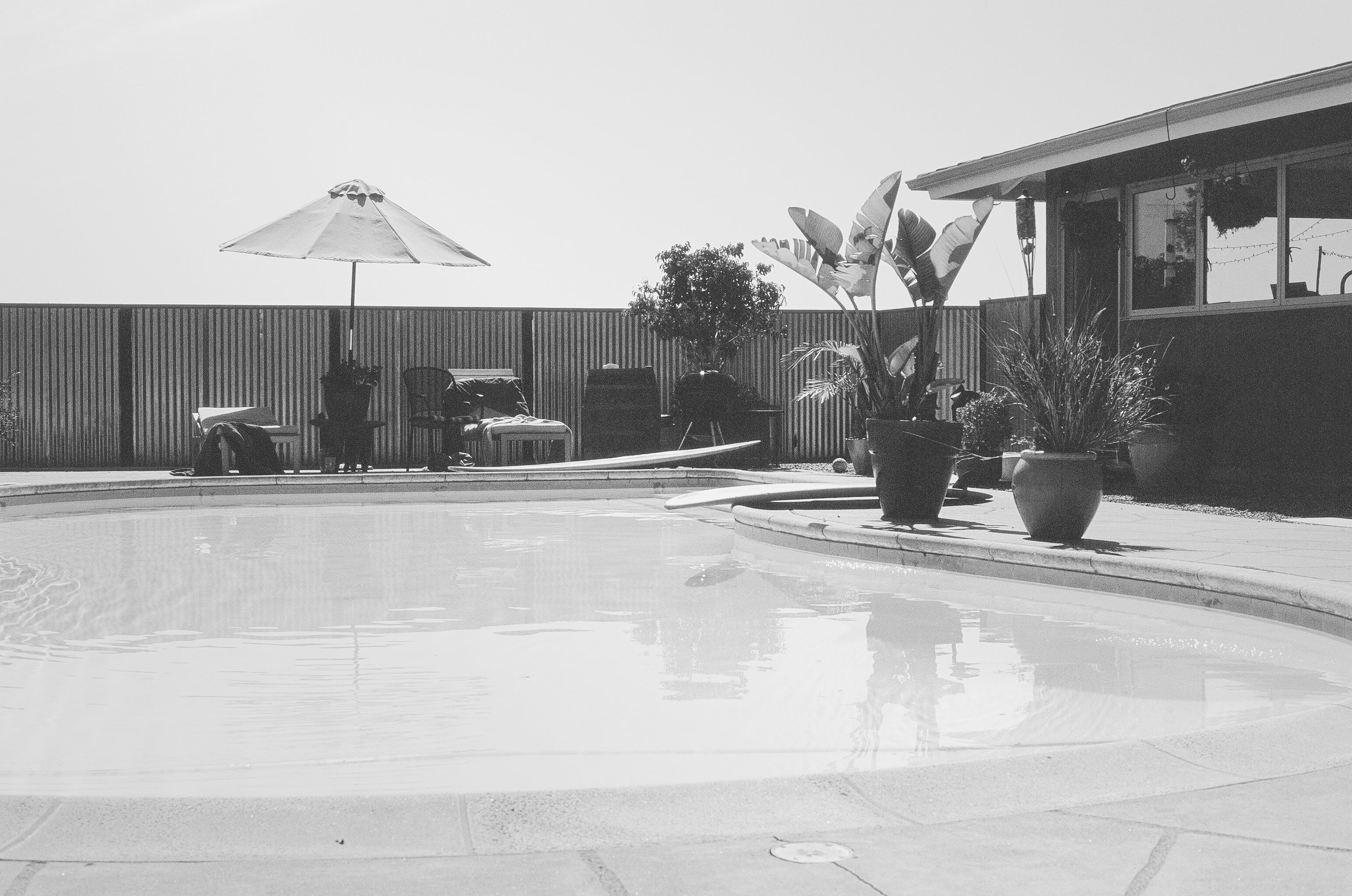 Grayscale Photography of Swimming Pool