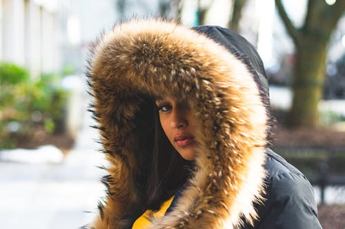 Woman Wearing Brown And Black Parka Coat