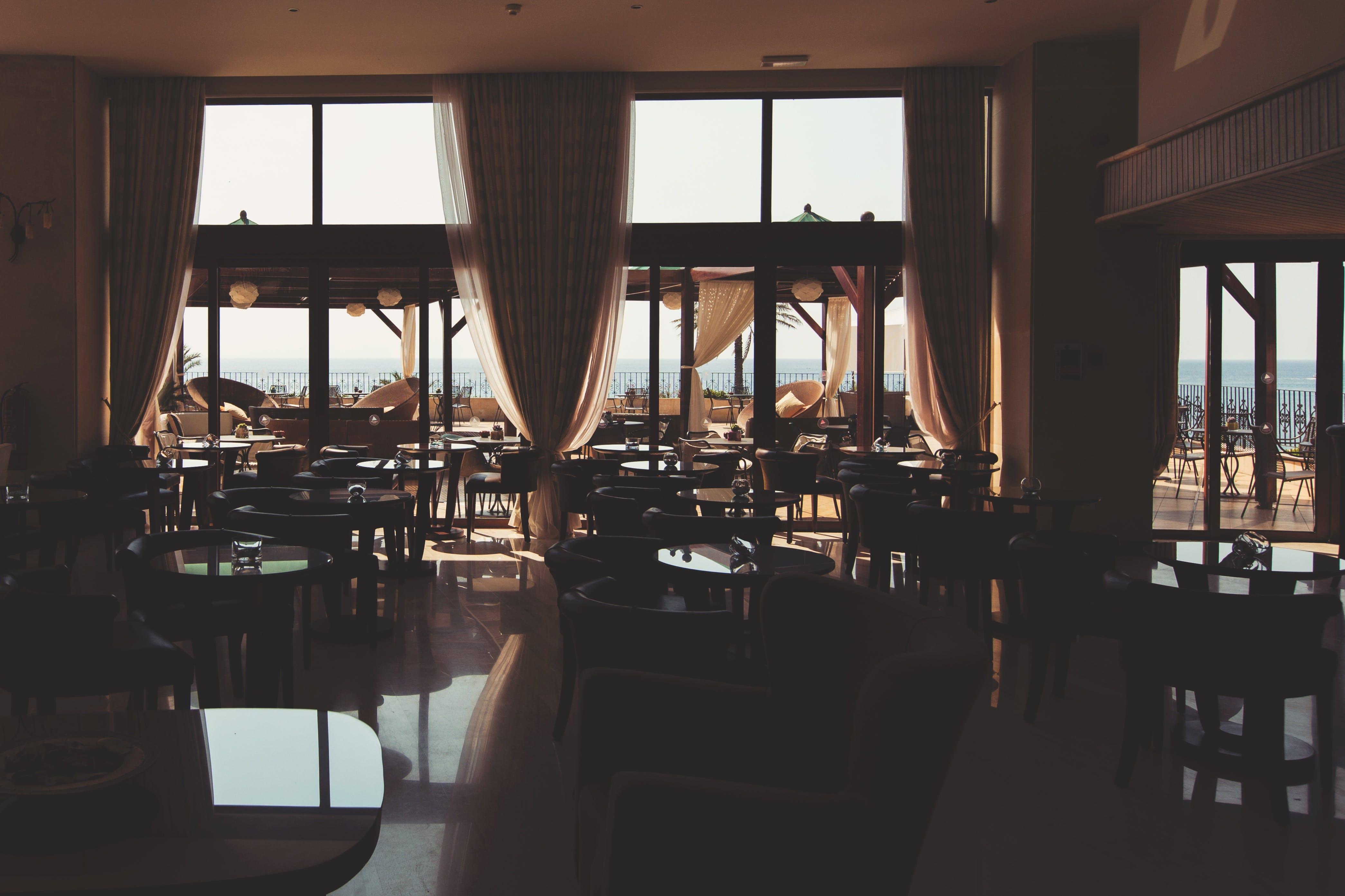 Cafe Table Near Glass Wall