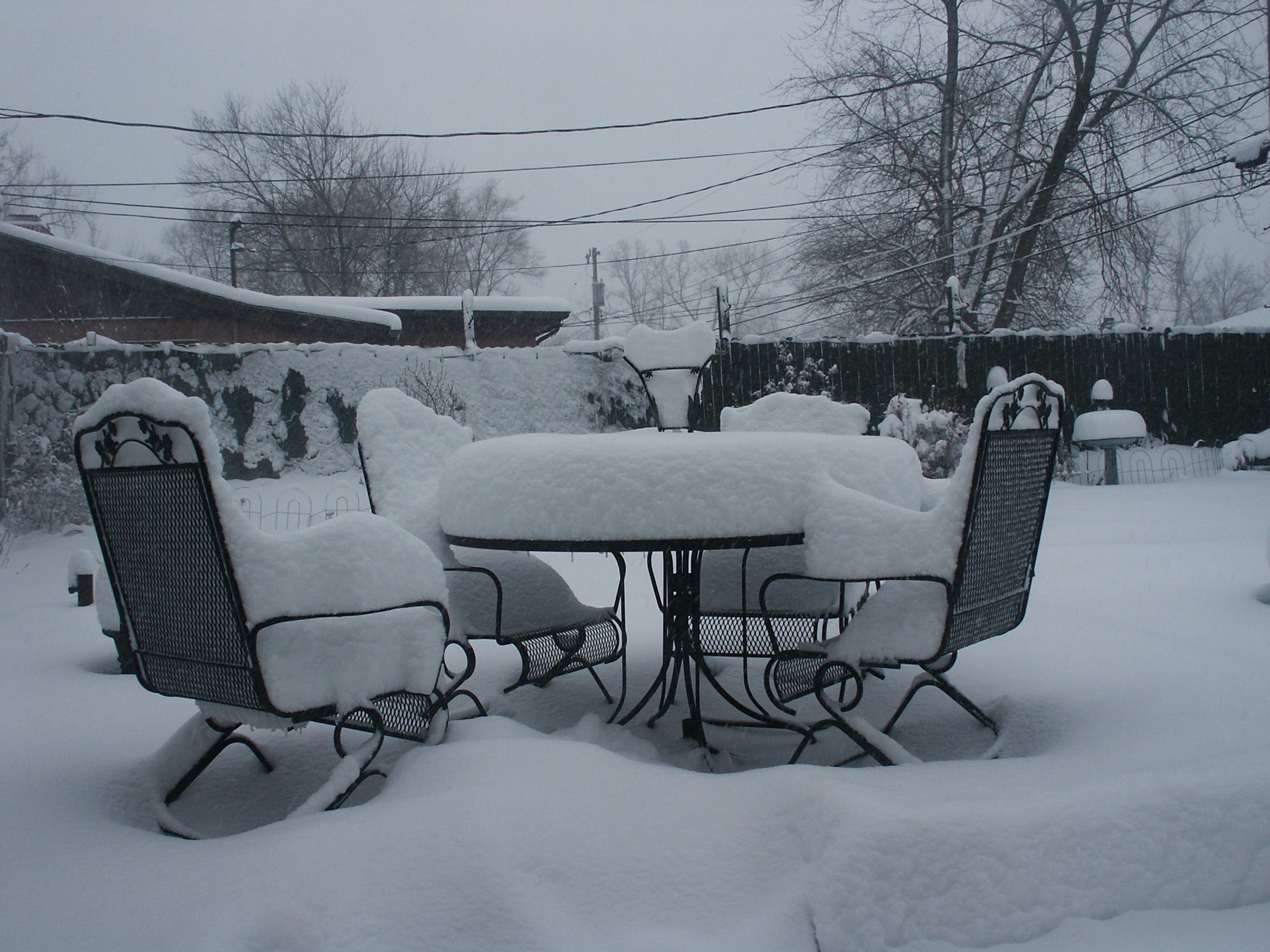 Black Patio Table and Chairs Covered of Snow