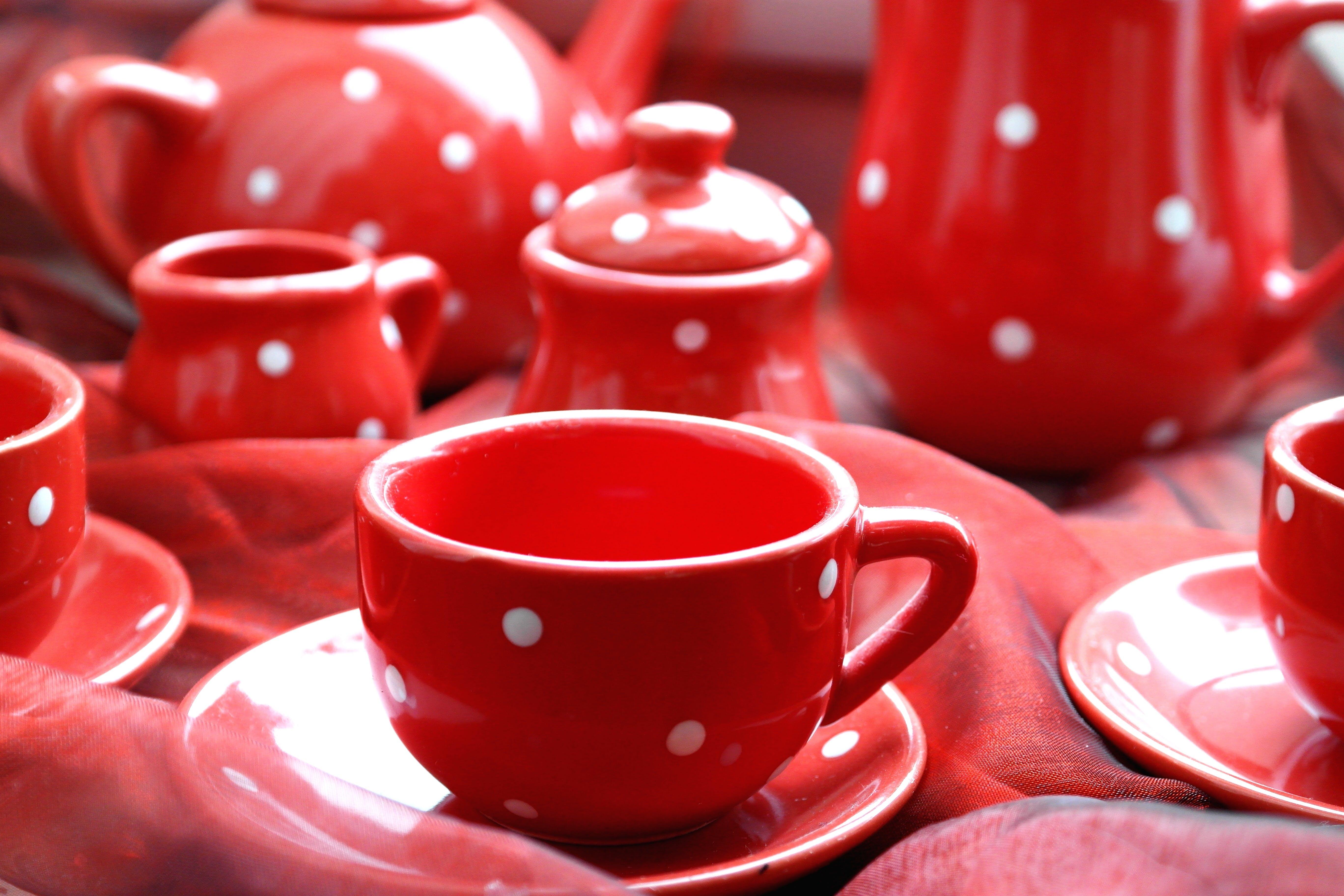Pink Ceramic Coffee Mugs Beside Tea Pot
