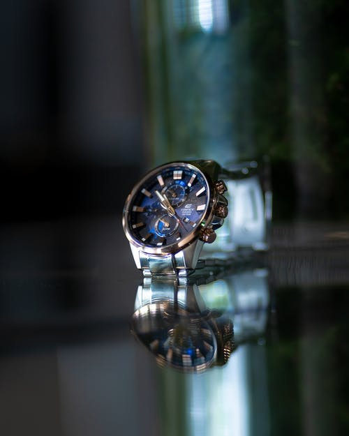 Selective Focus Photography Of Round Silver Chronograph Watch
