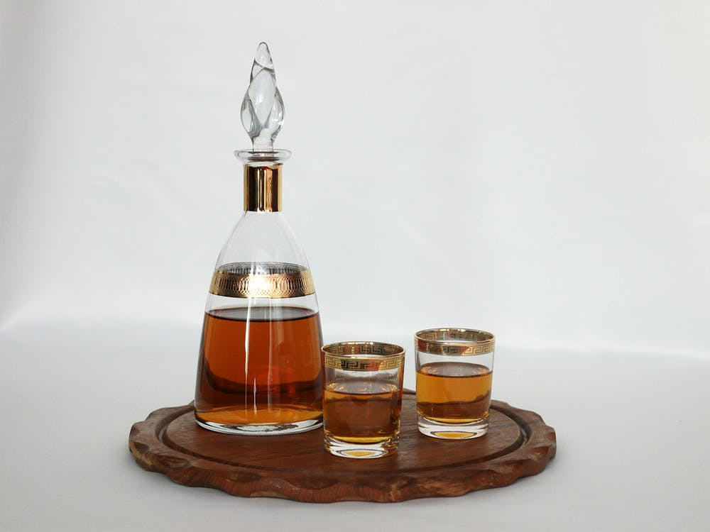 Clear Glass Decanter Beside Two Drinking Glasses