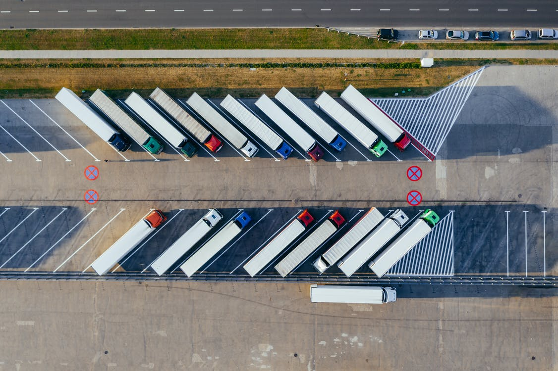 Aerial Photography Of Trucks Parked
