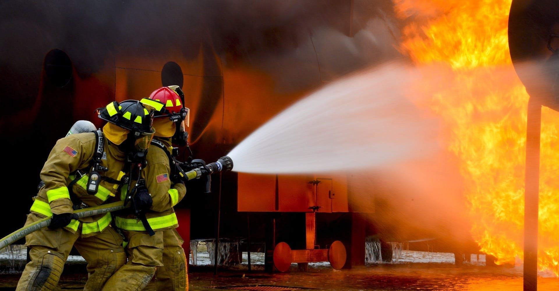 Firemen Blowing Water on Fire