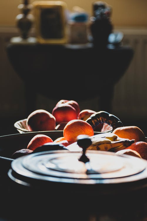 Selective Focus Photography  of Fruits in a Bowl