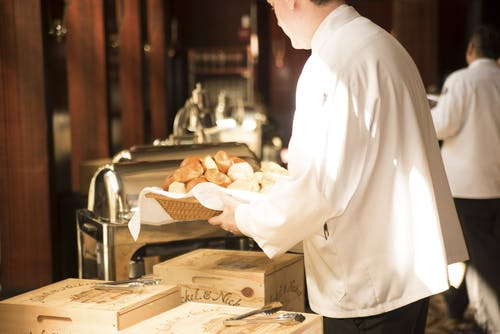 Chef Holding Tray With Breads