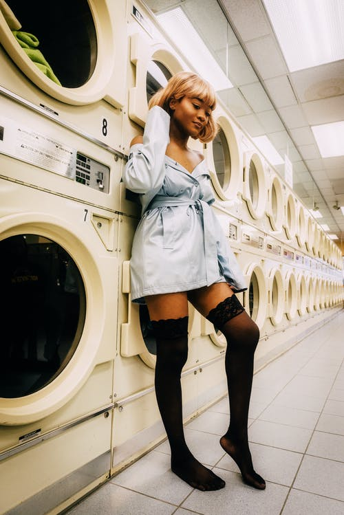 Photo Of Woman Leaning On Washing Machines