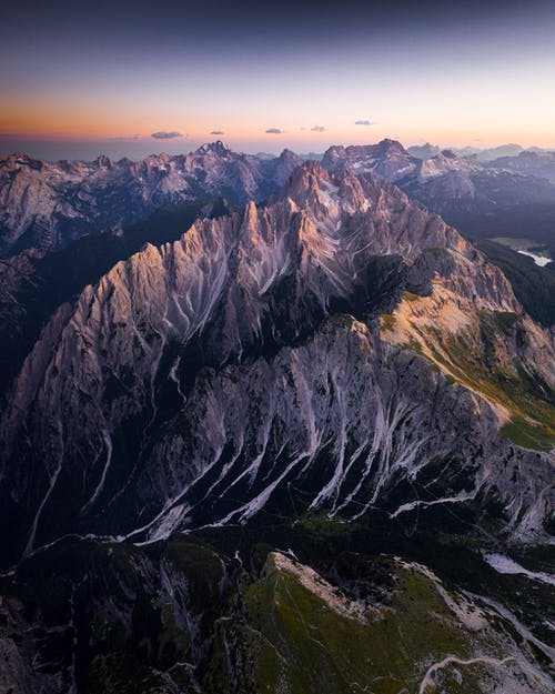 Bird's Eye View Of Mountains During Dawn