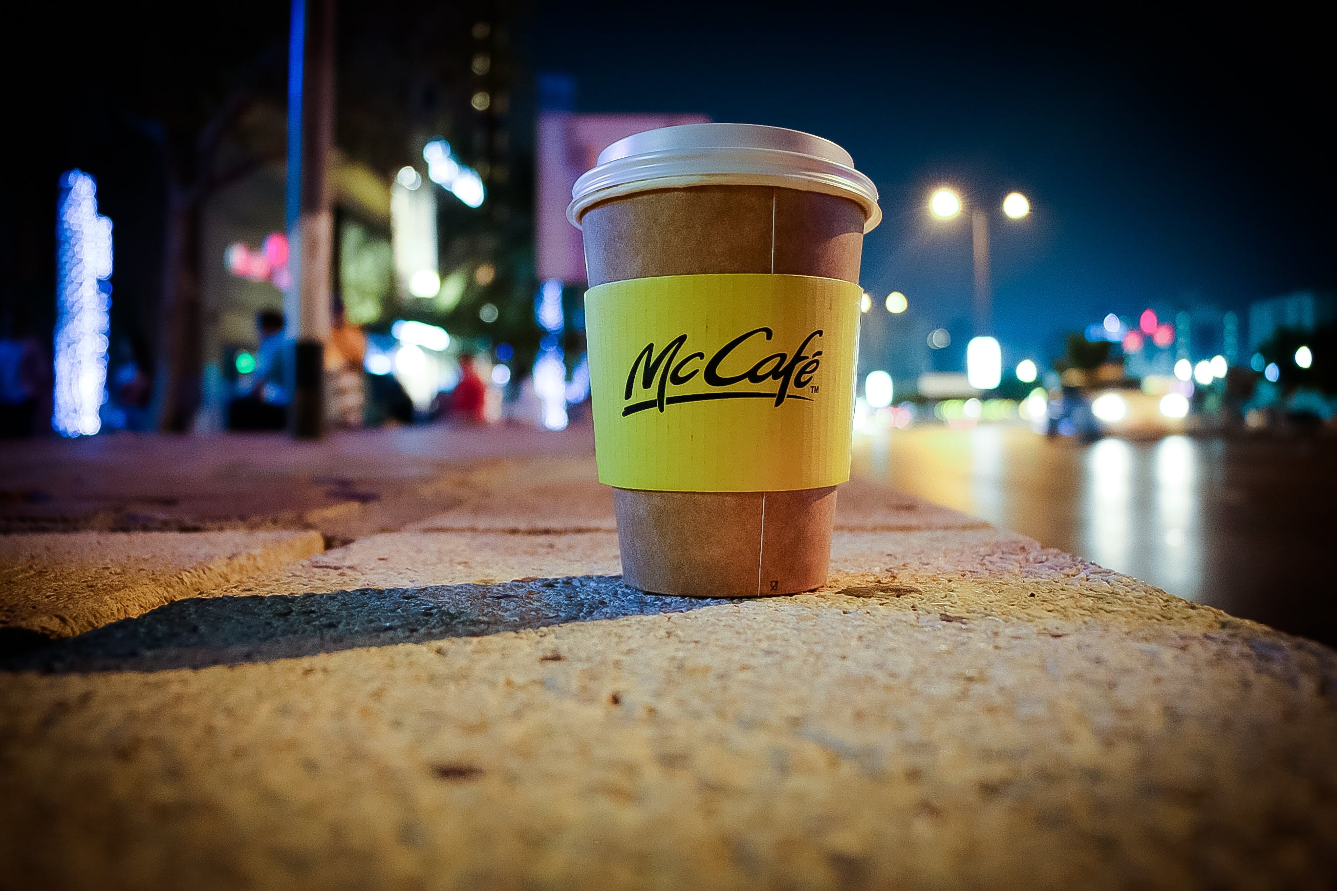 Mccafe Disposable Coffee Cup on Road