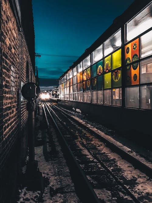 Train Near Glass Walled Building