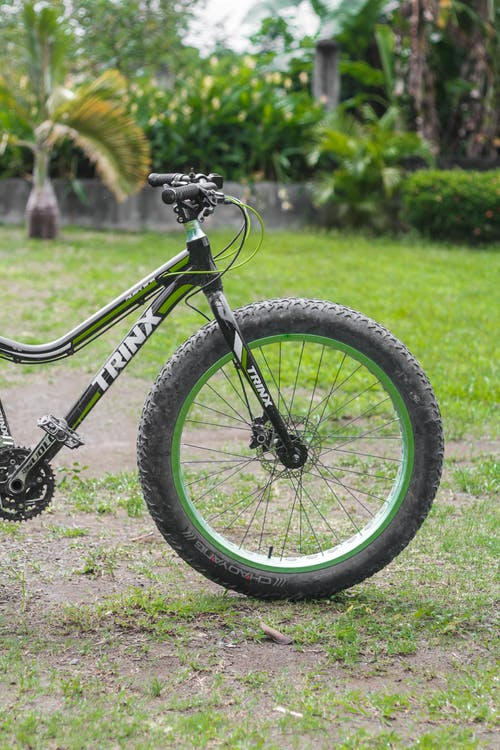 Black and Gray Full Suspension Mountain Bike on Green Grass Field