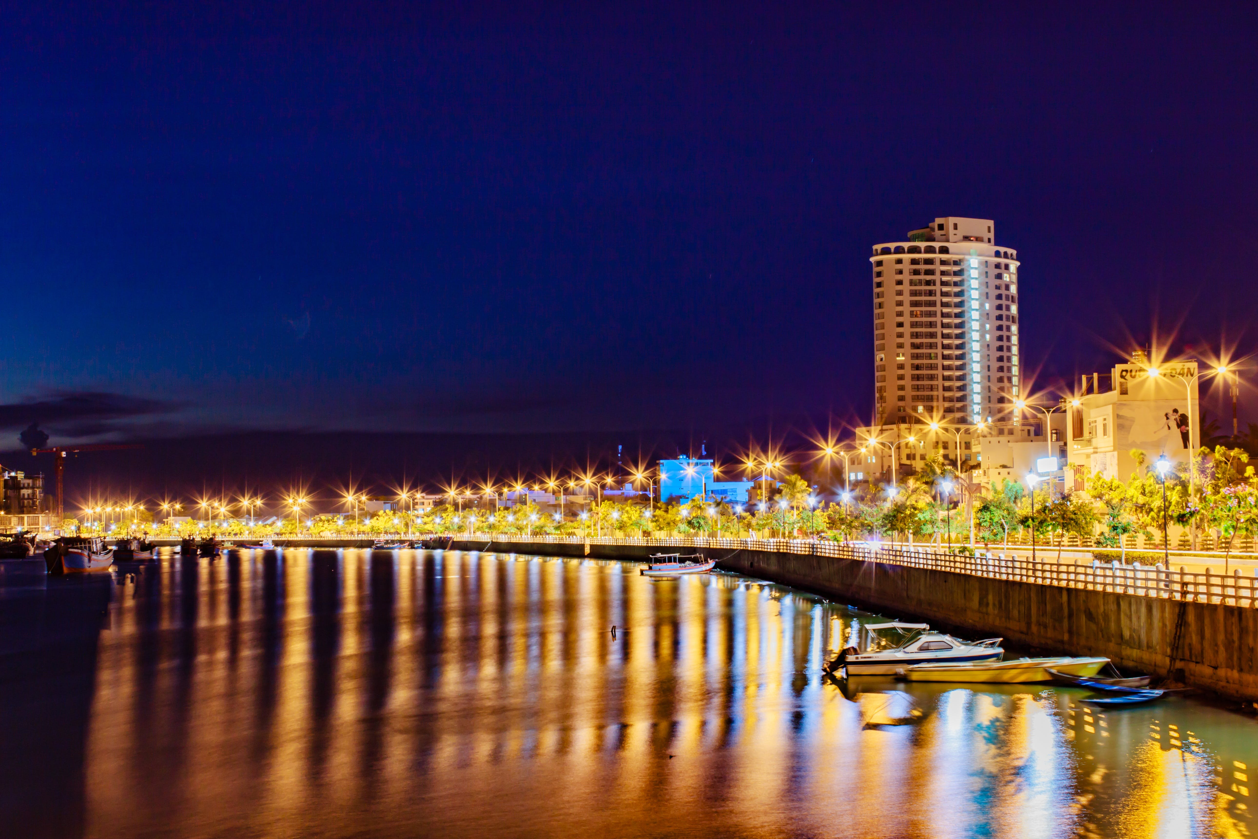 City Beside Body of Water at Night With Lights Landscape Photography