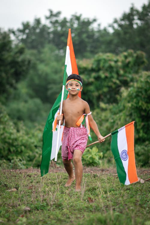 Kid Holding Two Indian Flags