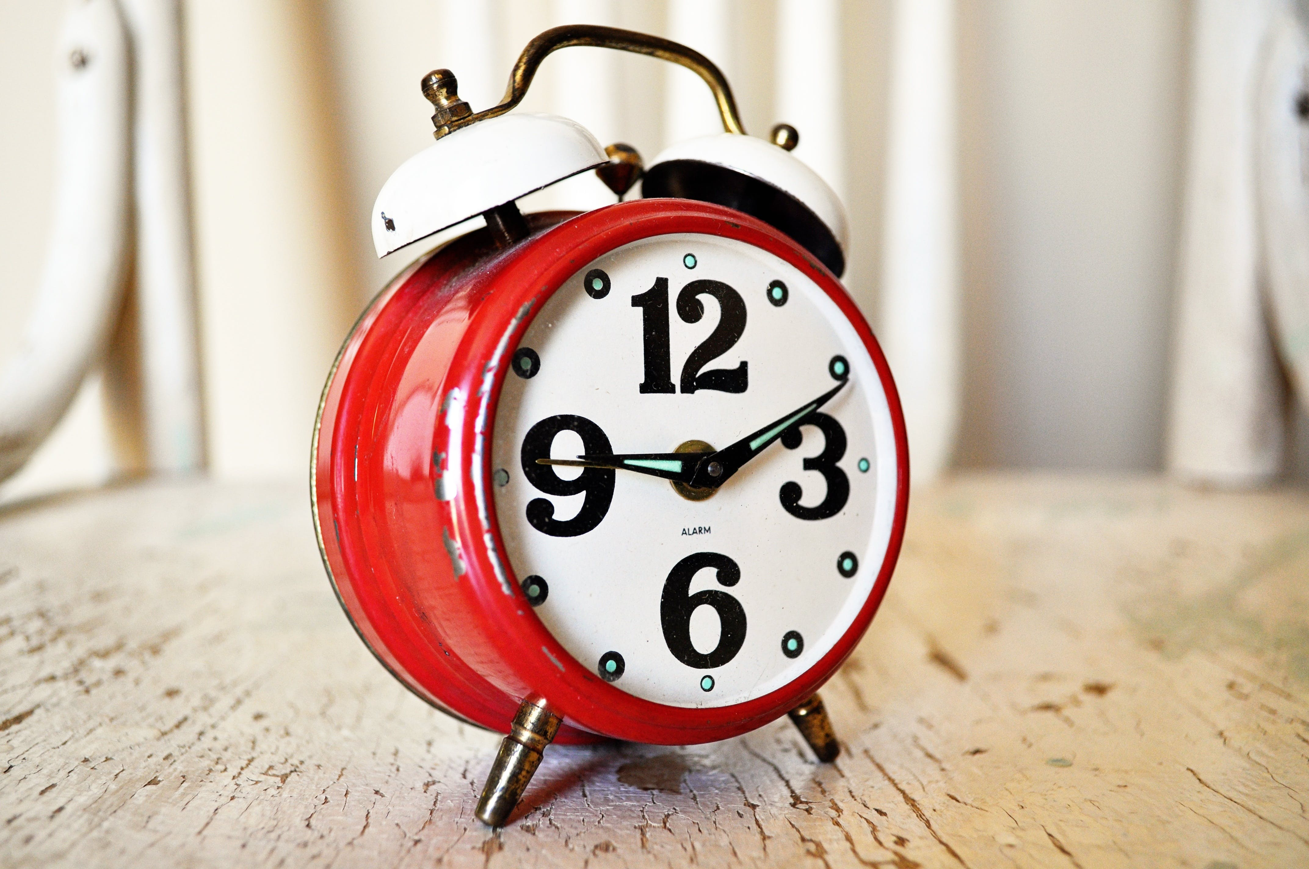 Red and White Alarm Clock Displaying 9:11