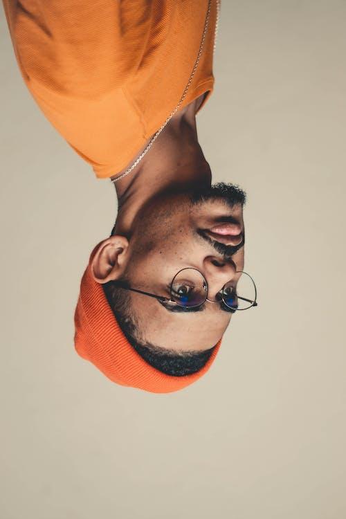 Man Wears Orange Knit Cap and Shirt