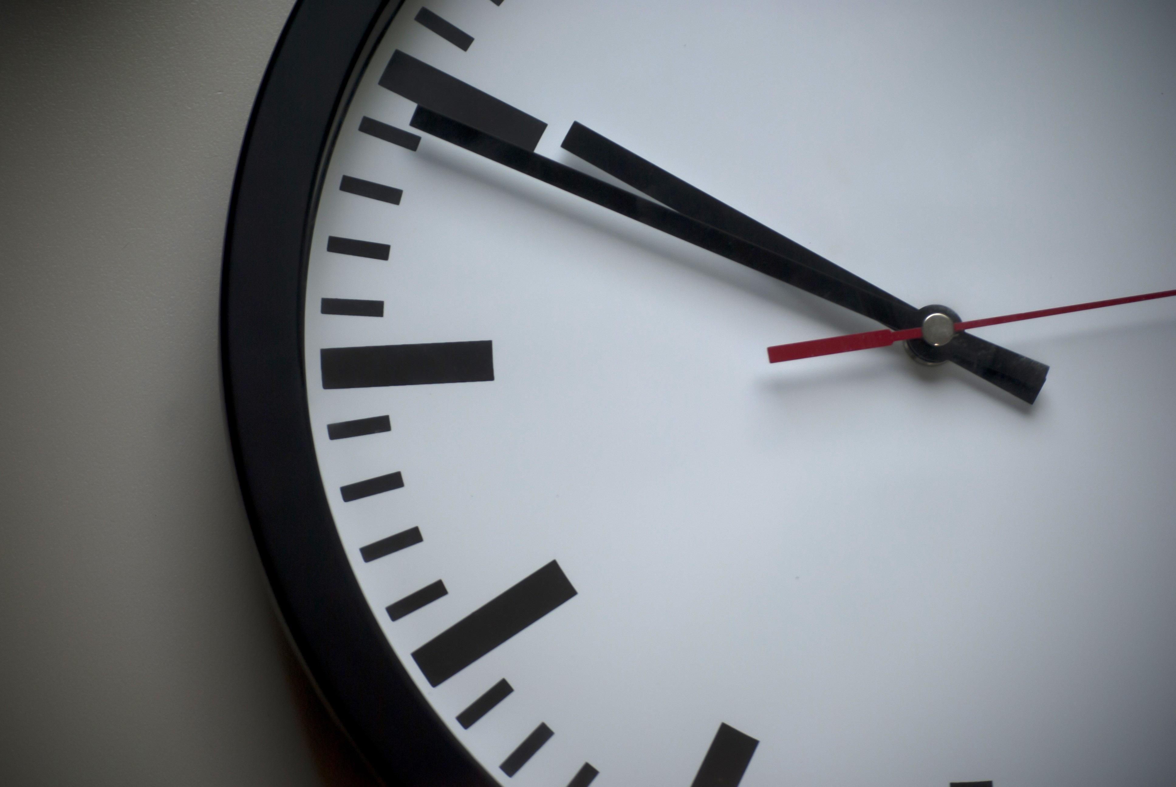 Shallow Focus Photo of White Analog Clock