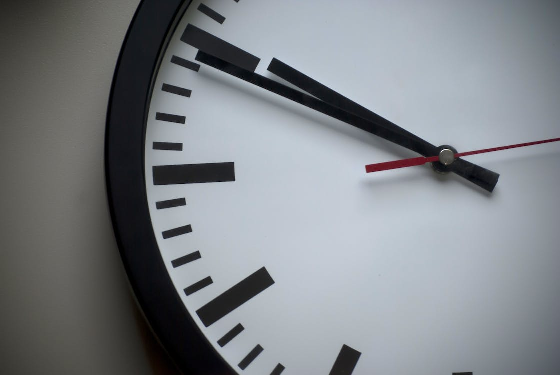 Shallow Focus Photo of White Analog Clock