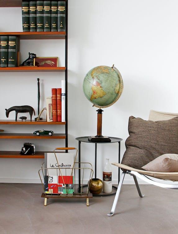 Desk Globe on End Table Beside Chair