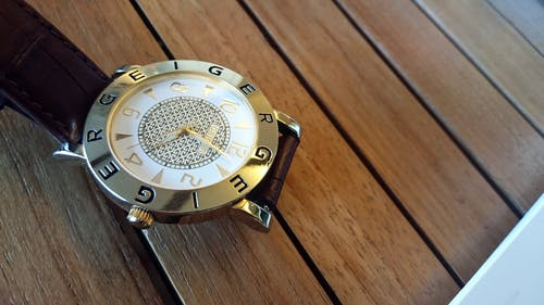 Round Silver-colored Analog Watch at 4:02