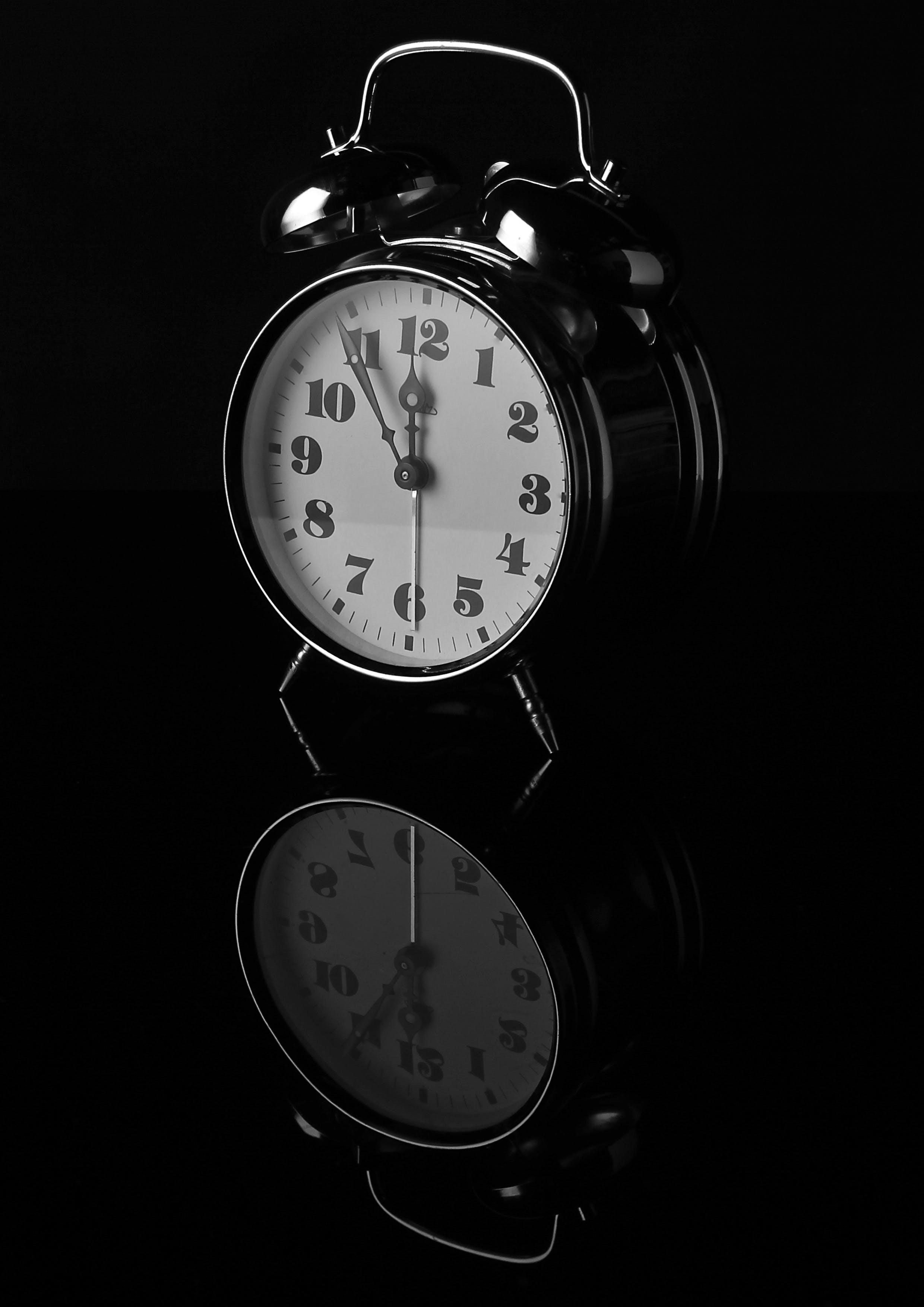 Black Alarm Clock Displaying 12:55