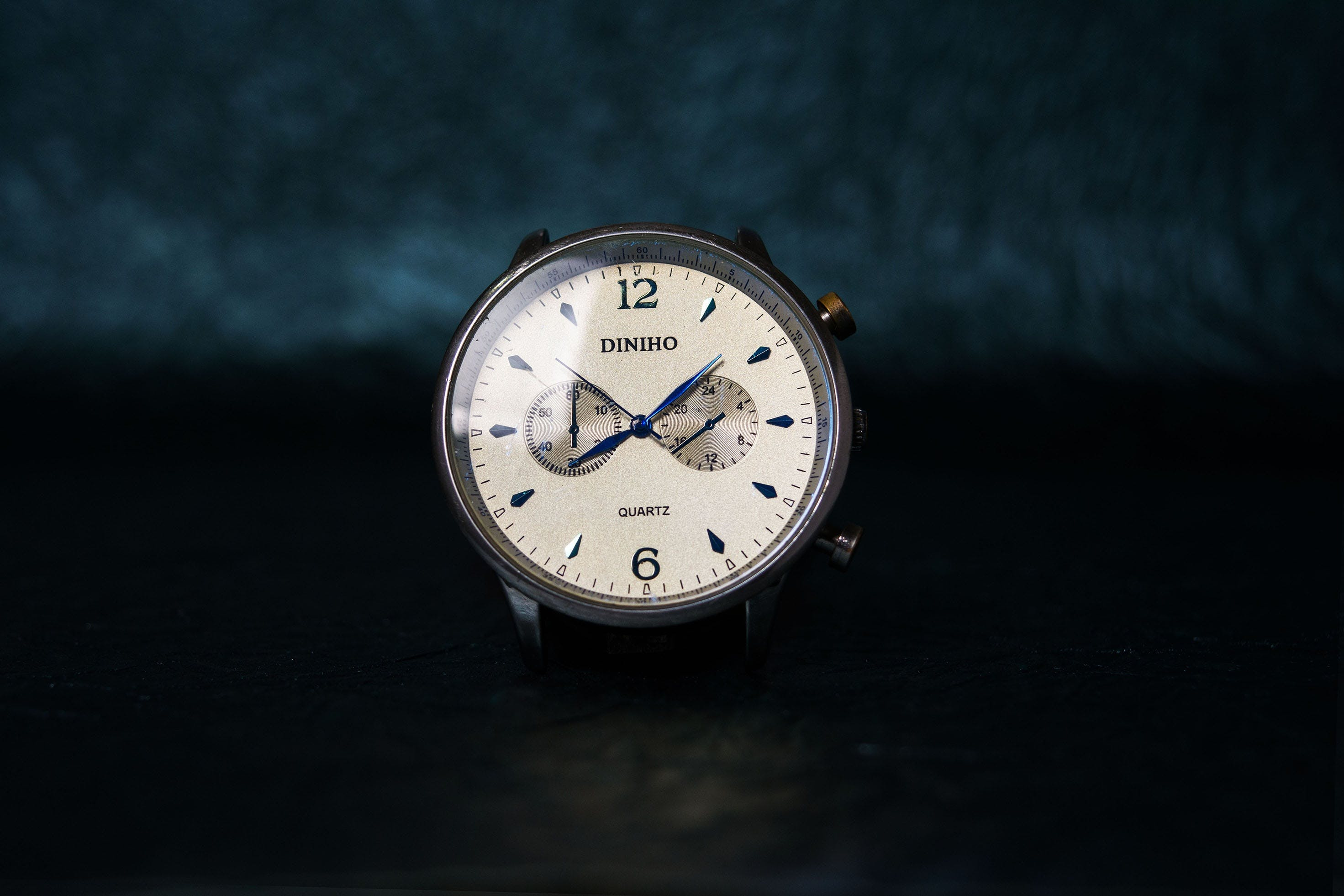 Round Silver-colored and White Chronograph Watch