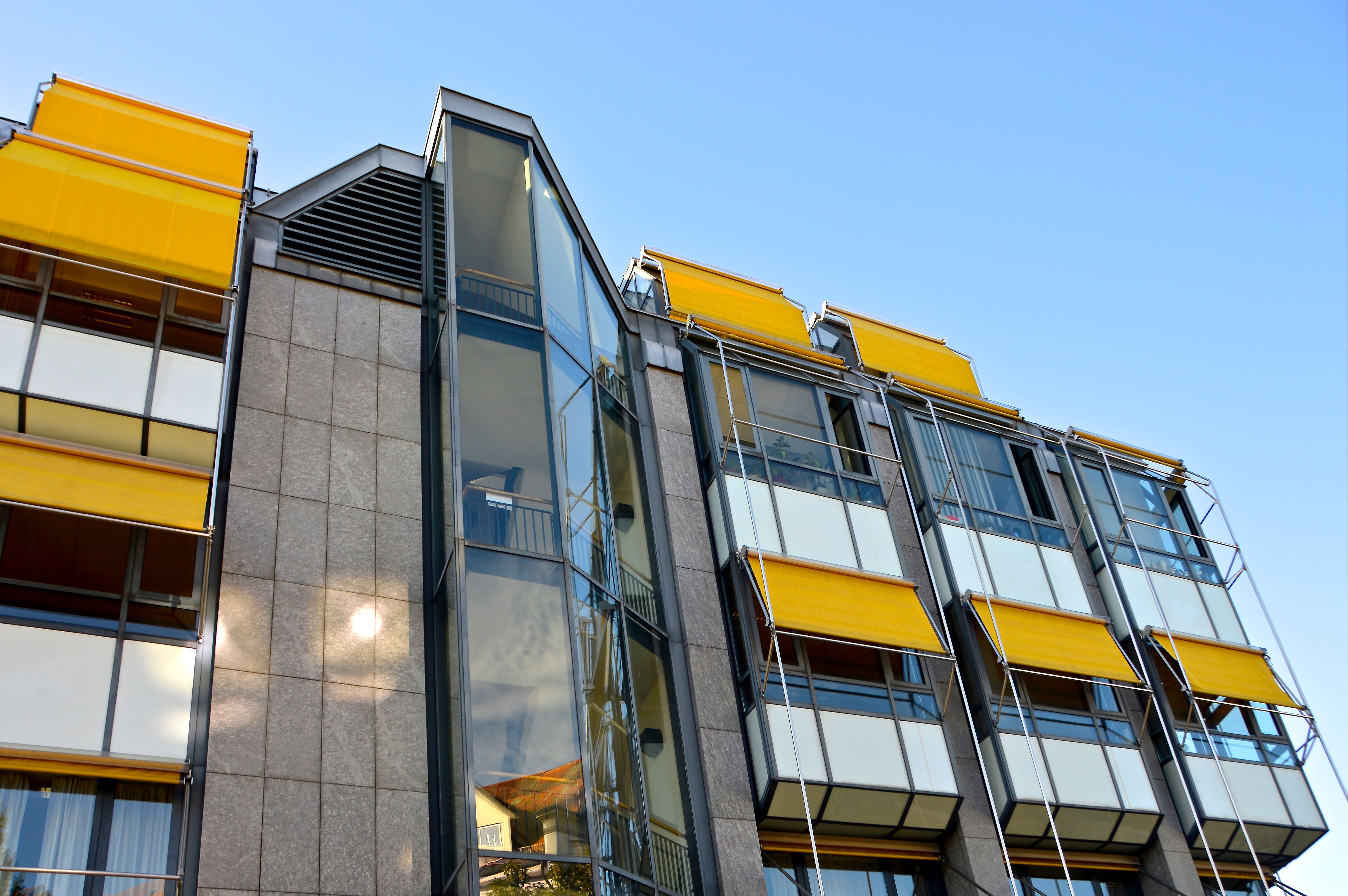 Worm's Eye View of Gray and Yellow Building