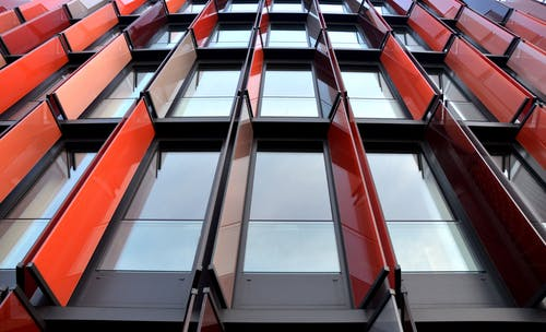 Low Angle Photography of Red Metal Building
