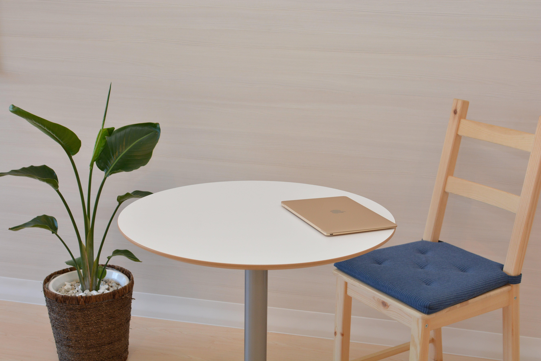 Macbook on Pedestal Table