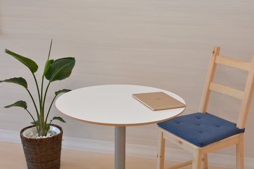 Macbook on Pedestal Table