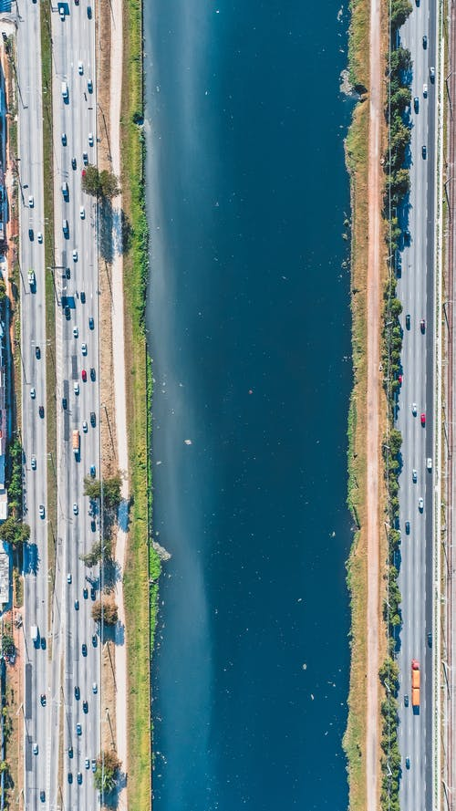 Aerial View of Canal Between Roads