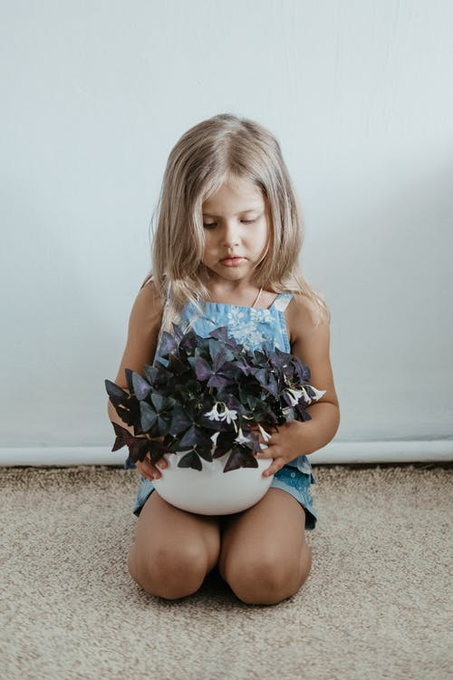 Girl With Plant on Her Knees